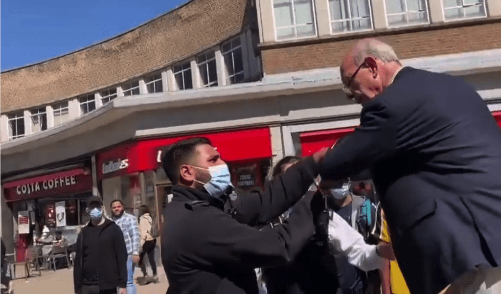 street preacher pulled down